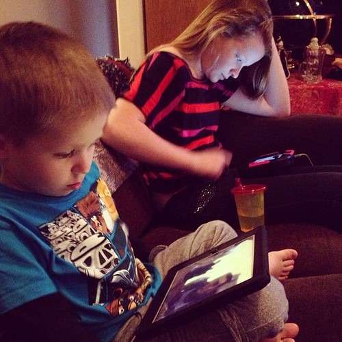 Z & cousin Jessi on their devices.