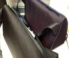brown(0.0), leather(0.0), horse tack(0.0), car seat(0.0), bag(1.0), handbag(1.0), messenger bag(1.0),