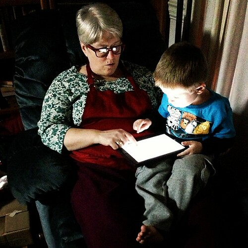 Zachary shows Angry Birds Star Wars to Gram Z during a break from preparing Christmas dinner