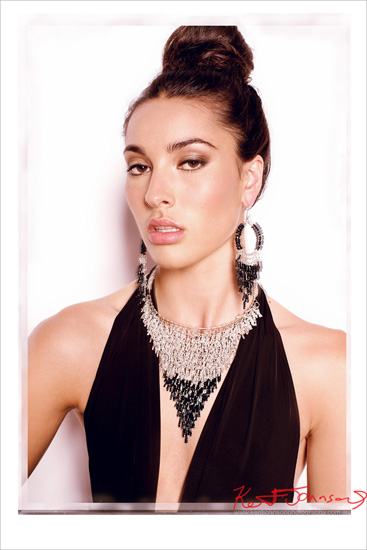 Fashion portrait for a jewellery campaign, model wearing black evening dress with black beaded necklace, braclets and matching earings. Photography by Kent Johnson.