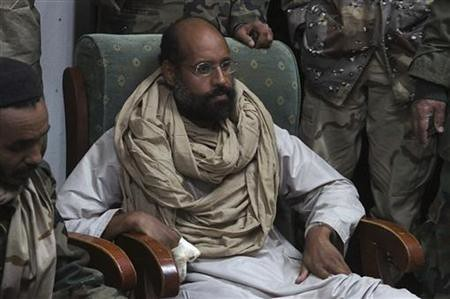 Seif al-Islam Gaddafi, the son and heir apparent to martyred Libyan leader Col. Muammar Gaddafi, appeared in a rebel court on January 17, 2013. His sham trial has been postponed. by Pan-African News Wire File Photos