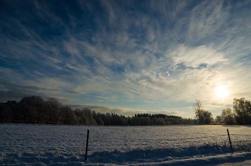 blue winter sky sun snow clouds landscape sverige västragötalandslän