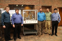 Motor Component Reclamation System Team with poster