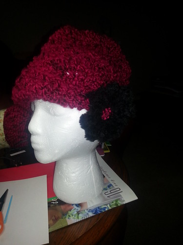 red hat with black/red flower by The Colorful Crafter