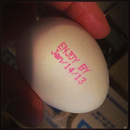 In California a tiny man individually hand letters the expiration date on each egg