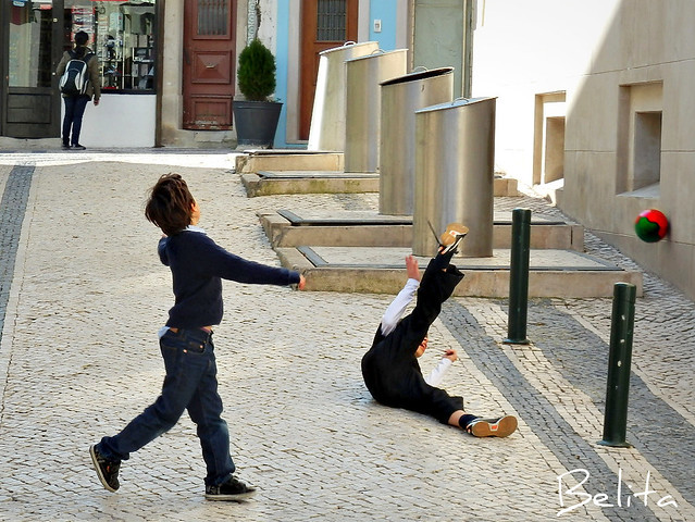 Boys playing on a street in Cascais summer resort