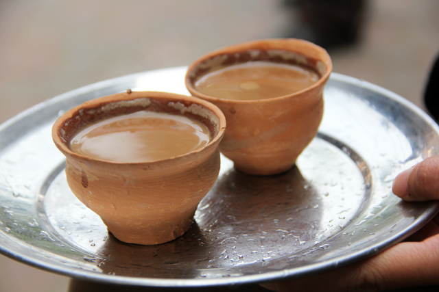 Two freshly poured cups of chai!