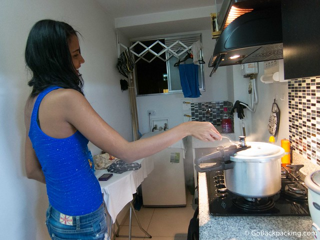 Viviana releasing the steam from the pressure cooker