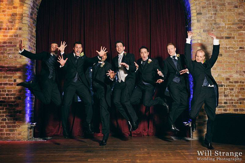 Andy jumping with his groomsmen