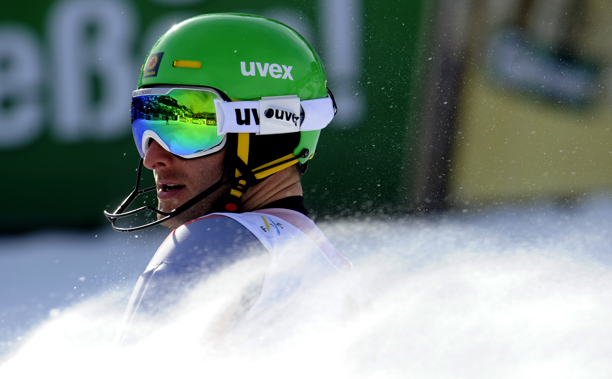 Mike Janyk kicks up spray at the finish of the men's slalom in Kitzbühel.