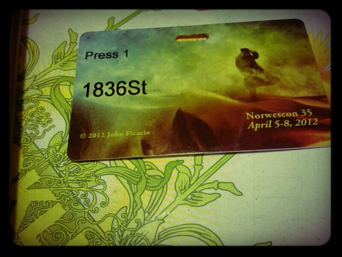 image of a press pass for Norwescon, resting on a table