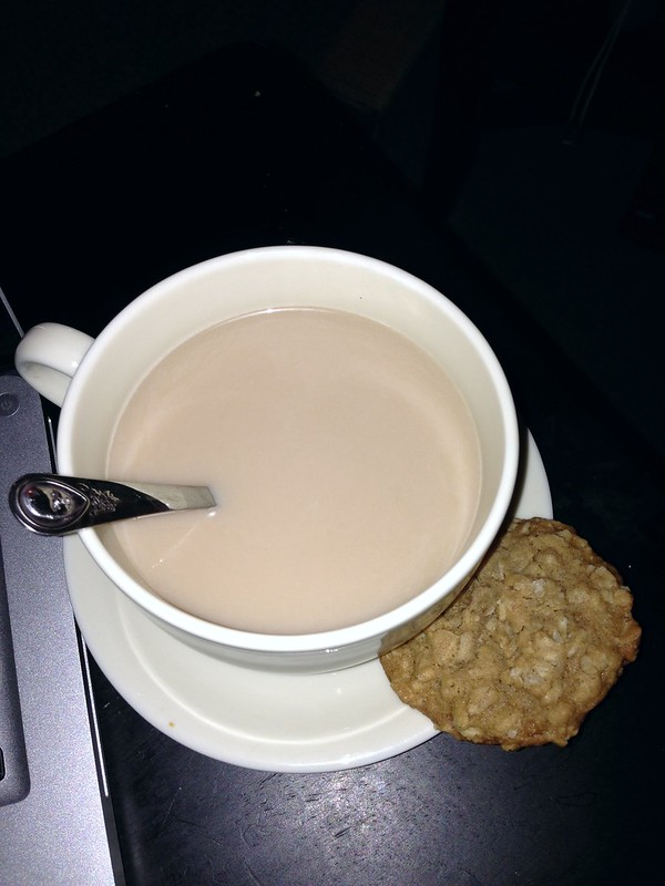 Inside, warm drink and a cookie