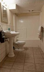 Lower level bathroom with tile flooring