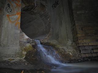 Backwash  Sudden runoff from something upstream..