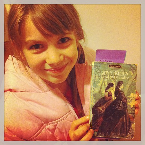 So proud that 11 year old Laura is reading her first Jane Austen novel. #books #smiles
