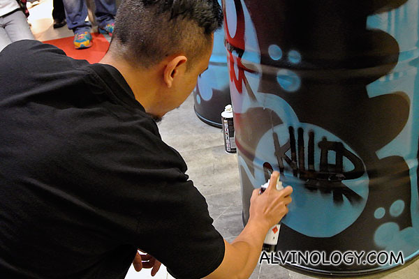 Spraying his signature