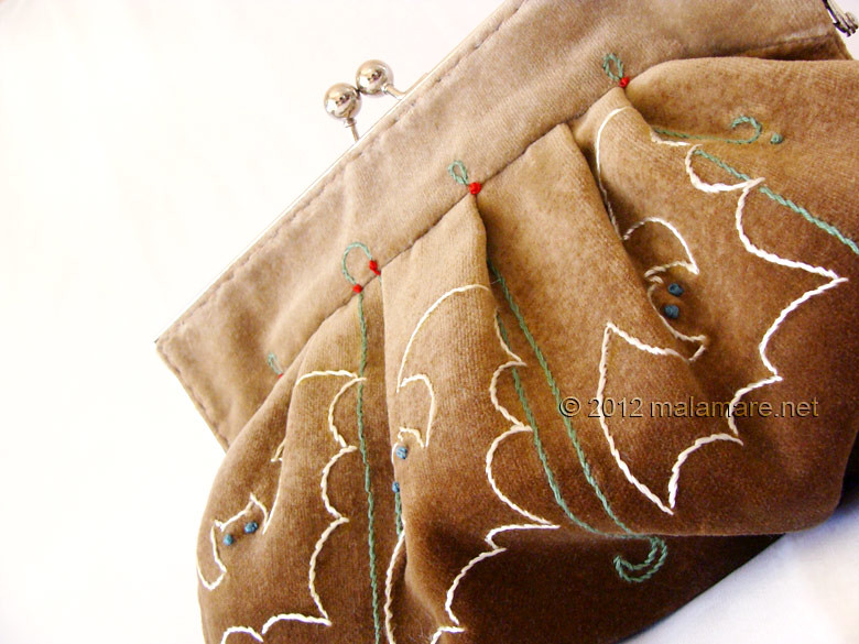 Brown velvet clutch bag with bat hand embroidery and purse frame embroidery detail