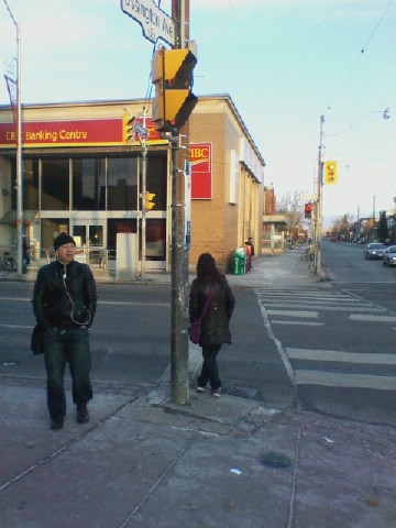 Waiting for the bus, Bloor and Ossington.