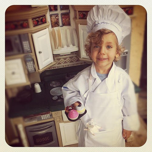 I am dying from the cuteness. Finn loves the kitchen and chef's outfit from my mom (including a personally embroidered hat).