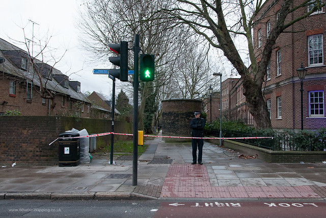 behind the police tape lies the crimescene where a bullying asian coward stabbed a lone woman The path leading from The Highway to Wapping Woods has been sectioned off by the Police forensic team