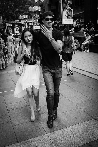 A trendy couple posing for the camera as they walked down Orchard Road.