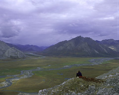 Person on rock above Arctic National Wildlife Refuge