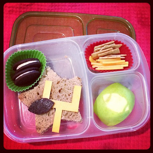 Super Bowl lunch today - pb&j star sandwich, cheese goal post, fruit leather football, apple , joe joes cookies #easylunchboxes #kidslunch #whatsforlunch #superbowl