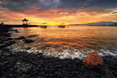 ocean travel sunset sea sky bali cloud sun seascape motion reflection water stone clouds sunrise canon indonesia landscape photography eos boat dock sand agua colorful asia exposure waterfront view vibrant explorer wave explore filter shore 7d usm filters polarizer efs 1022mm hdr tonal waterscape contras eastasia colourfull candidasa canonefs1022mmf3545usm balibeach gnd f3545 sillhuette sillhuet canon7d manbutur manbuturphotography