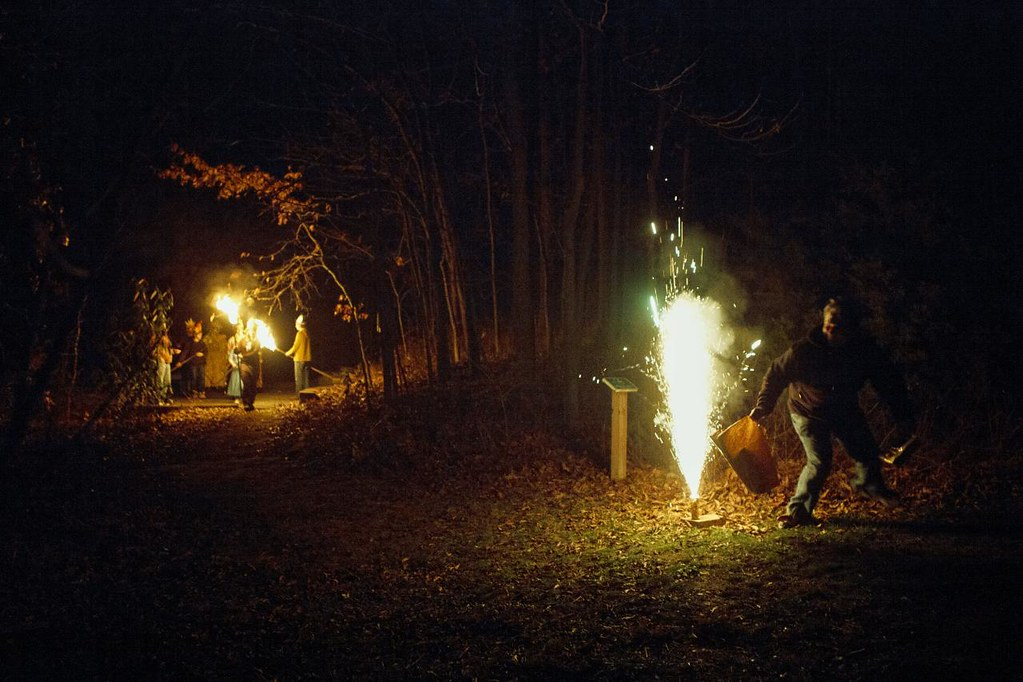 SARAH HOFFMAN/Missourian  Torch bearers wait in the woods to light the bonfire at the Unitarian Universalist Winter Solstice Celebration on Dec. 15, 2012 at the Unitarian Universalist Church.