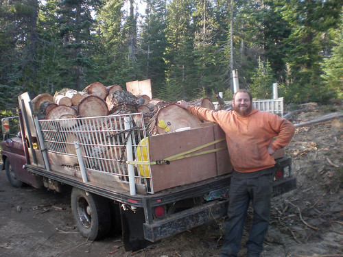 A firewood gatherer stands proudly with his truck load of cut firewood from the Mt. Hood National Forest in Oregon. More than 600 cords of wood were cut and cleared from the Barlow Ranger District in partnership with Wasco County, Oregon. (U.S. Forest Service Photo)