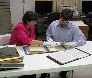 Staff reviewing archival items prior to storage.