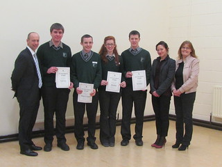 Sixth year students, N. Milsom, S. Curran, A O'Neill, C. Sheridan receiving academic excellence awards from NUI Maynooth