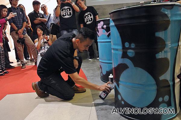 Killer Gerbil spray painting his artwork on-the-spot
