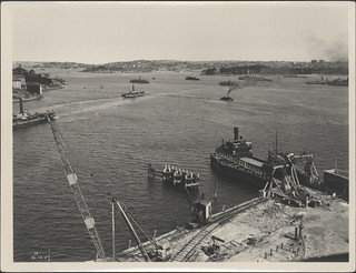 Ferries and boat during the construction of Sydney Harbour Bridge, 1927