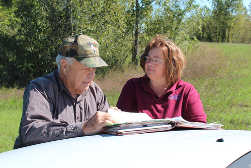 Ron Farris, landowner, and NRCS employee Danette Cross look over his conservation plan.