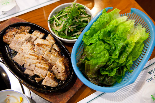Manul Samgyup Gui (pork belly) with a basket of fresh lettuce and seasoned chives and onions