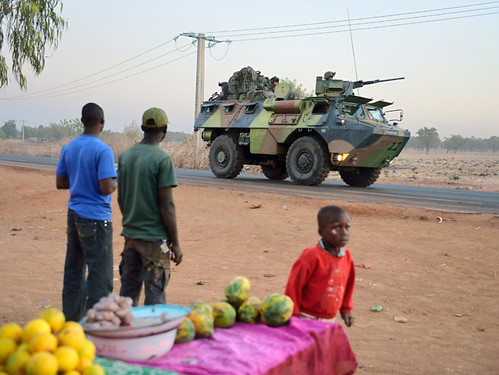 Malian people look at a French armoured vehicle as French soldiers leave Bamako and start their deployment to the north of Mali as part of the operations on January 15, 2013 . by Pan-African News Wire File Photos
