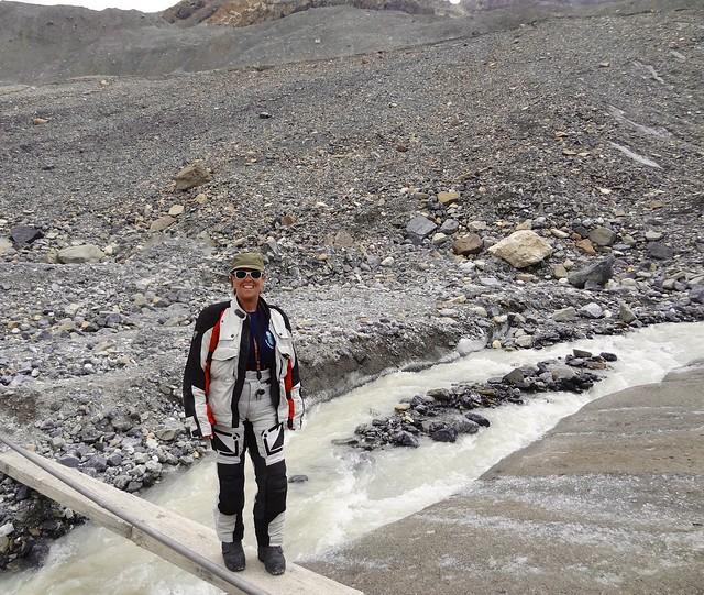 Sara crossing the glacier melt stream