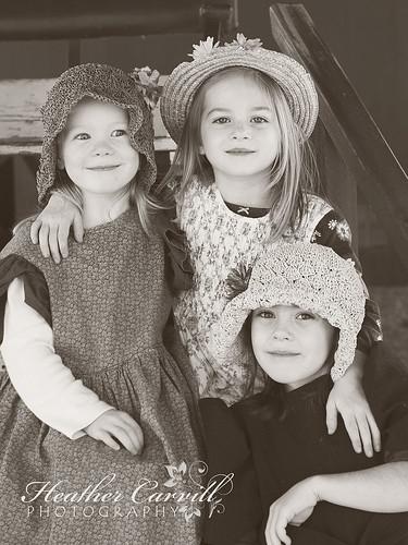 Three girls playing dress up