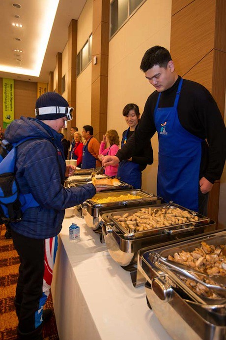 January 31st, 2013 - Yao Ming serves breakfast to Special Olympics athletes with wife Ye Li
