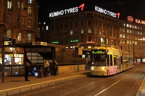 Advert covered Flexity tram arrives at Frankfurt am Main Hauptbahnhof