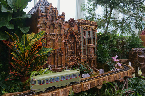 Streetcar passes by models at the New York Botanical Gardens Holiday Train Show