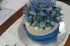 buttercream(0.0), torte(0.0), wedding cake(0.0), cake(1.0), flower(1.0), purple(1.0), fondant(1.0), sugar paste(1.0), food(1.0), cake decorating(1.0), icing(1.0), birthday cake(1.0),
