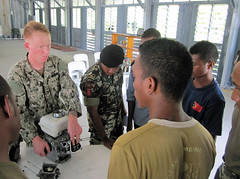 A U.S. Navy Seabee conducts training with members of the Federal Defense Force Timor-Leste (F-FDTL) Navy during a previous CARAT exercise in Timor-Leste. (U.S. Navy/Cmdr. Jennie Stone)