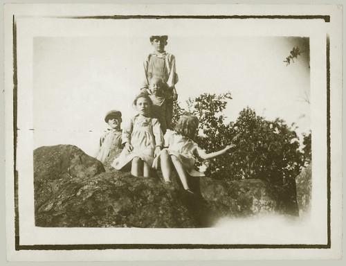Five children on a rock.