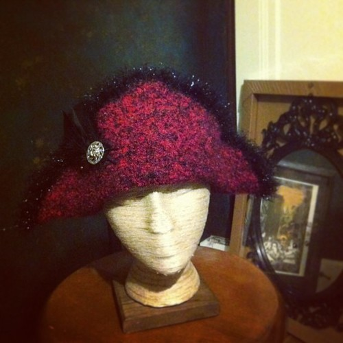 New bicorne, with faux-ostrich pouf trim. I sort of love making these—so much bang for the buck. #HatterAtLarge