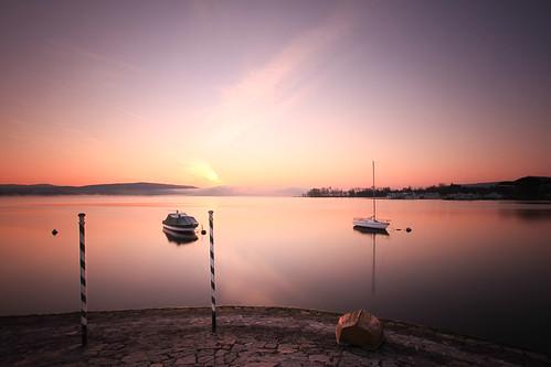 longexposure lake sunrise boats lago dawn alba barche lagomaggiore waterscape canon1022 nd110filter libralato canoneos7d lucalibralato pwpartlycloudy