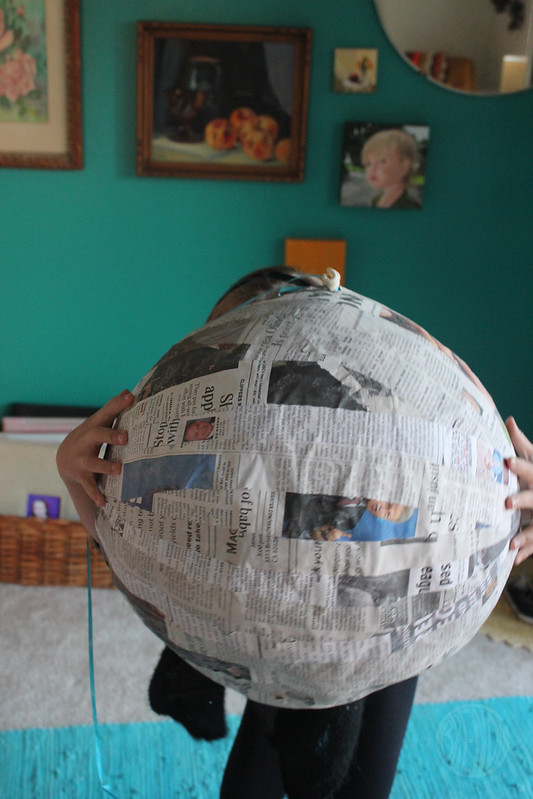 got the whole wide newspaper orb, in her hands