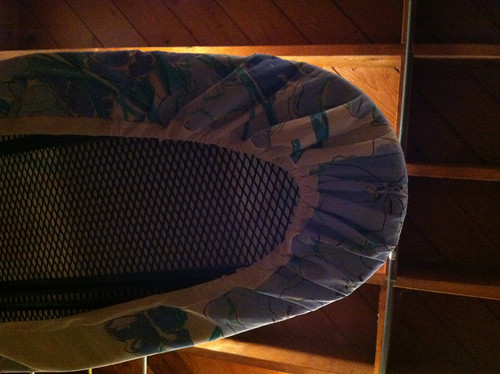 the bottom of the ironing board cover