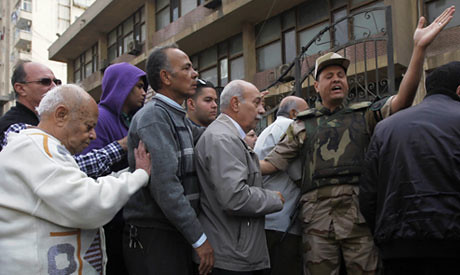 Egyptian crowds line up to participate in the December 15, 2012 national referendum on the draft constitution. Demonstrations and boycotts have mared the process. by Pan-African News Wire File Photos
